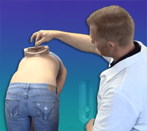 Classic Adam's test with scoliometer to check for scoliosis